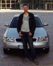 Как и принято у парней - рядом с машиной:)