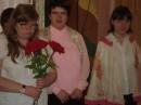 Я нахожусь в клубу с друзьями, я стою с розами первая с лева! Фото снята 2008 году