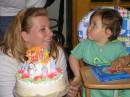 Я с мамой и тортом... а там сверху крестный... он спрятался
