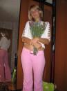 Она сама цвИток, а цветы, ей, так к лицу.